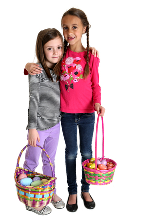 cute young girls hugging holding Easter baskets photo