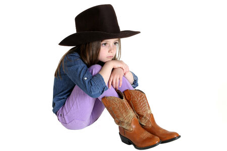 knees up: cute young cowgirl sitting with knees up