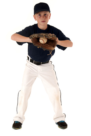 young caucasian baseball player catching the ball