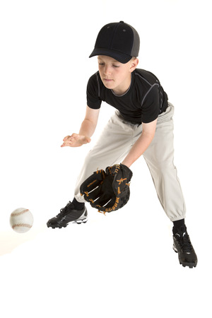 young boy baseball player catching a grounder