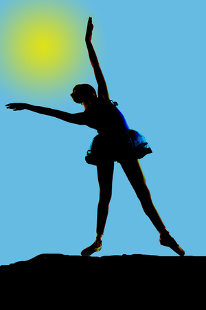 Young ballerina silhouette stretching towards the sun photo