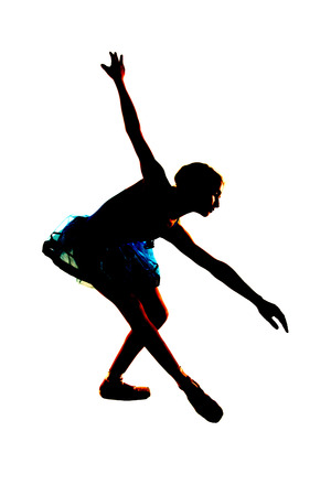 bending over: Silhouette of young ballerina stretching bending over Stock Photo