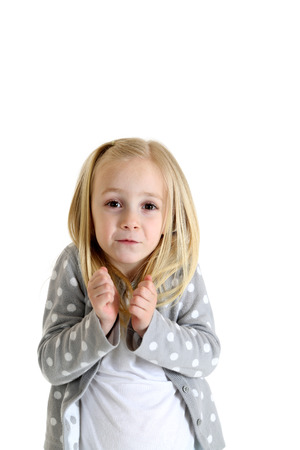 shrugged: young girl with funny expression shrugged shoulders Stock Photo
