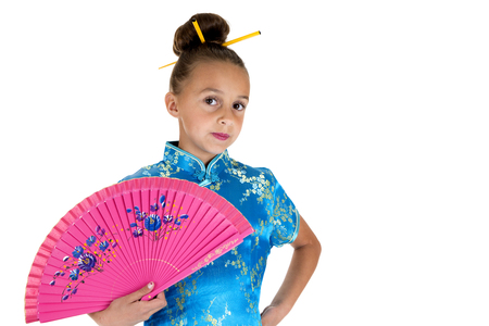 girl dressed in oriental gown holding fan photo