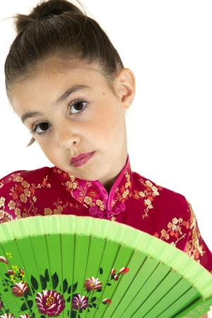 beautiful girl wearing chinese dress holding fan  photo