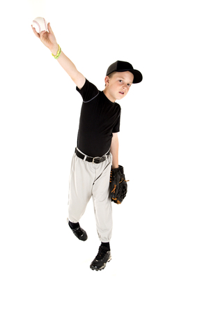 pitching: young boy in uniform pitching a baseball Stock Photo