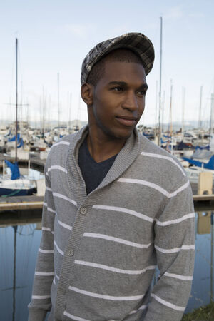 black male: black male model wearing sweater newsboy hat Stock Photo