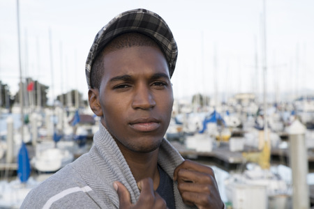 newsboy cap: male model wearing newsboy cap at marina