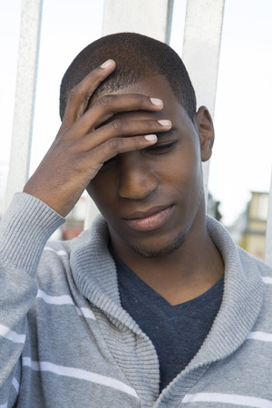 African American male model hand on head photo
