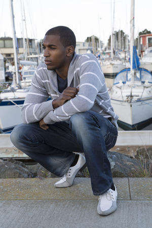 squatting down: African American male model portrait squatting down