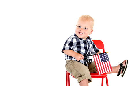 One year old boy holding American flag