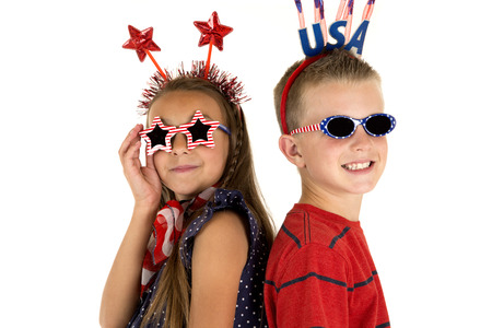 boy and girl wearing cute patriotic sunglasses