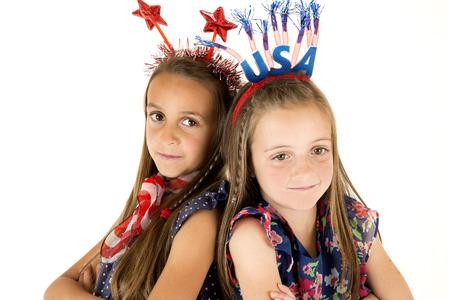 cintillos: chicas lindos que llevan diademas patri�ticos americanos sonriendo