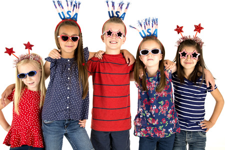 Five USA patriotic children arm in arm Stock Photo