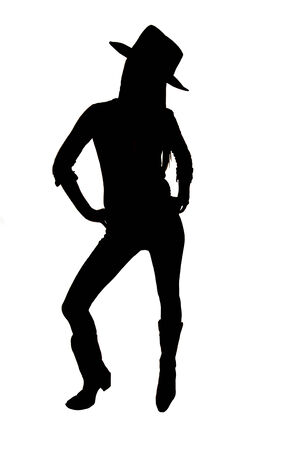 Silhouette of cowgirl with hat standing up