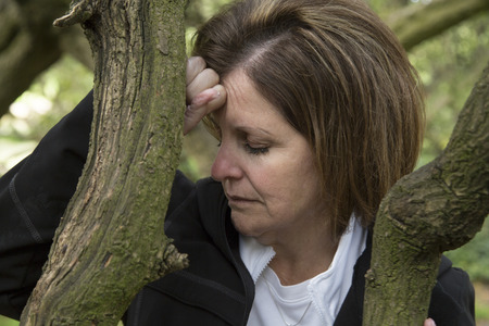 portrait of a depressed middle aged woman  Stock Photo
