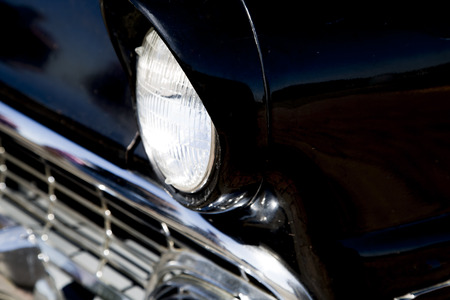 Sixties classic car front end close up photo