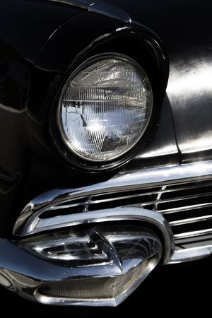 sixties classic black car headlight and grill photo