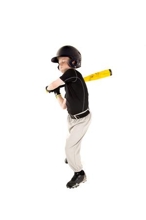 boy baseball player batting with eyes closed Stock Photo