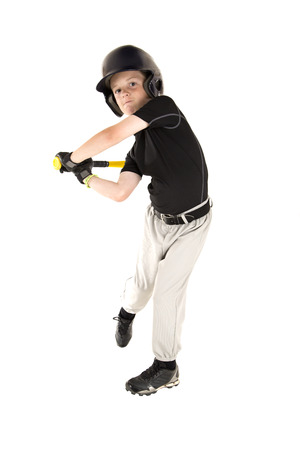 boy baseball player batting with eyes open Stock Photo
