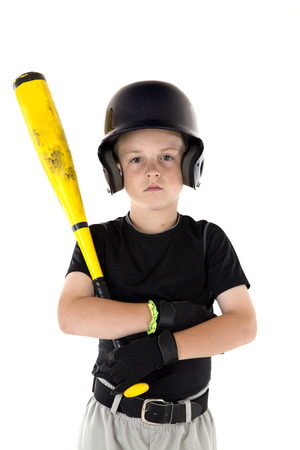 Small boy holding his baseball bat serious