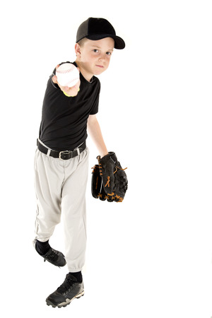Young baseball player throwing ball at camera