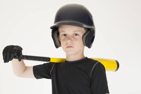 Young boy baseball player resting bat staring photo