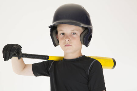 Young boy baseball player resting bat staring photo