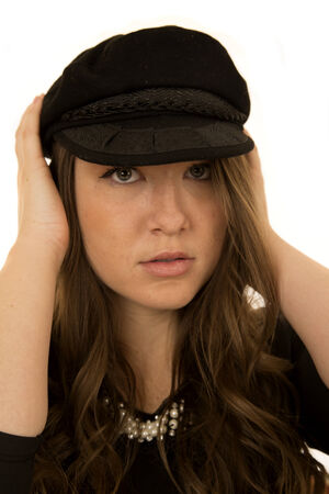 somber: Woman wearing black hat with somber look