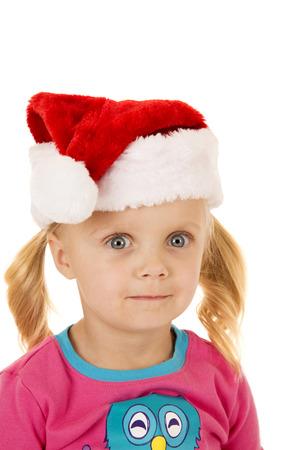 wide eyed: Wide eyed blond girl wearing santa hat Stock Photo
