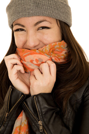 coy: Coy teen model wearing a beanie and scarf Stock Photo