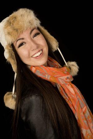 Confident ethnic teen wearing winter scarf hat photo