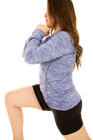 lunges: Female model doing lunges wearing blue top Stock Photo