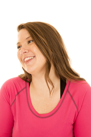 glancing: Female model wearing pink top glancing sideways