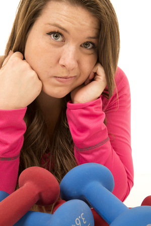 perplexed: Portrait of woman perplexed leaning into barbells Stock Photo