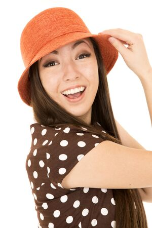 Excited young teen girl wearing orange hat photo