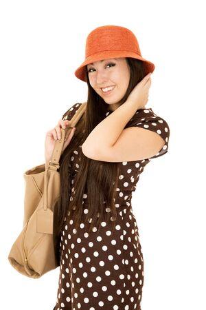 Smiling Asian American girl wearing brown dress photo