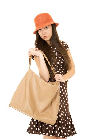 looking into camera: Teen girl with purse looking into camera Stock Photo