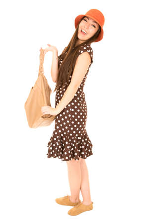 Smiling Asian American girl holding brown purse photo