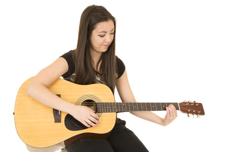 girl sitting down: Cute girl playing acoustic guitar sitting down