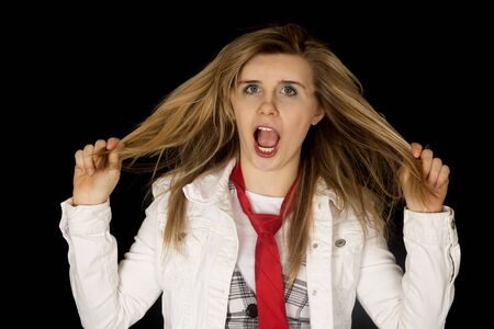 freaking: Freaking out female pulling hair black background