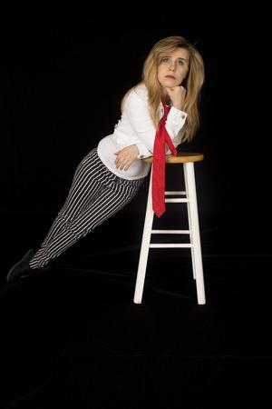barstool: female model leaning on barstool looking forward