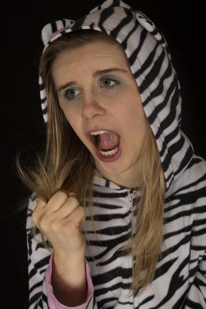closed fist: Woman wearing cat pajamas fist closed roar