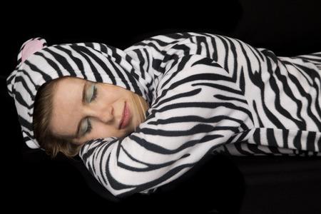 woman laying down: Woman laying down wearing cat pajamas asleep