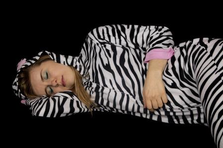 striped pajamas: Woman asleep laying down wearing striped pajamas