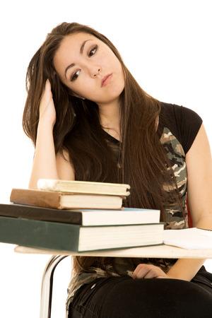 Girl at school desk fingers in hair photo