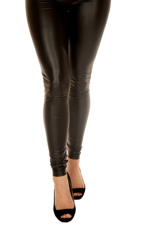 waist down: Front view of a woman wearing tight black leather pants waist down only Stock Photo