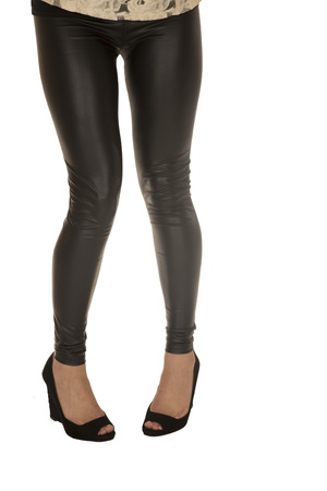 waist down: Fit woman wearing tight black leather pants and high heels waist down