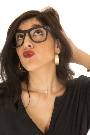 puckered lips: woman puckered lips looking up geek glasses Stock Photo