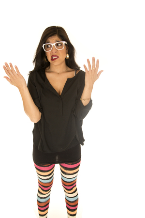 undecided: Unsure woman colorful leggings hands up undecided